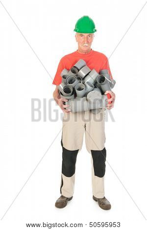 Plumber carrying many pvc pipes