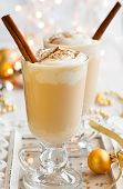 stock photo of cinnamon  - Egg Nog with Cinnamon Sticks - JPG