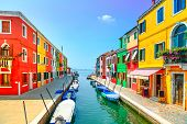 stock photo of colorful building  - Venice landmark Burano island canal colorful houses and boats Italy - JPG