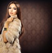 stock photo of mink  - Beauty Fashion Model Girl in Fox Fur Coat - JPG