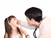 stock photo of pharyngitis  - The doctor inspect  a girls glands isolated - JPG