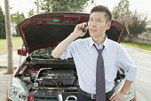 Businessman Calling for Roadside Assistance