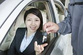 Mechanic Handing Keys to Businesswoman