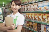 image of medium-  length hair  - Female Sales Clerk Working in a Supermarket - JPG