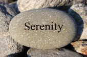 stock photo of sobriety  - Positive reinforcement word Serenity engrained in a rock - JPG