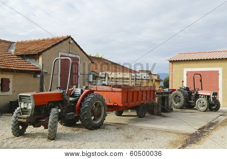 Tractors at the Chateau la Dorgonne winery yard in Provence