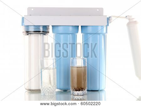 Filter system for water treatment with glasses of clean and dirty water  isolated on white
