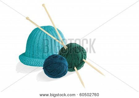 Two Balls Of Wool With Knitting Needles And Cap Isolated On White Background