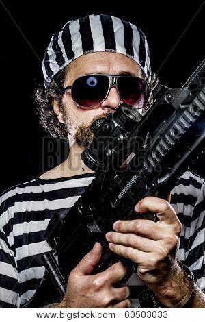 Opposition, Prison riot concept. Man holding a machine gun, prisoner