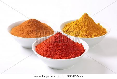 bowls with colorful spices piles