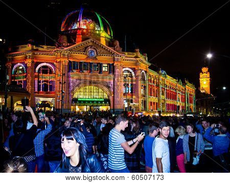 MELBOURNE - FEBRUARY 22: Flinders Street Station at Melbourne's White Night which attracted more than 500,000 visitors to the city centre - February 22, 2014 in Melbourne, Australia.