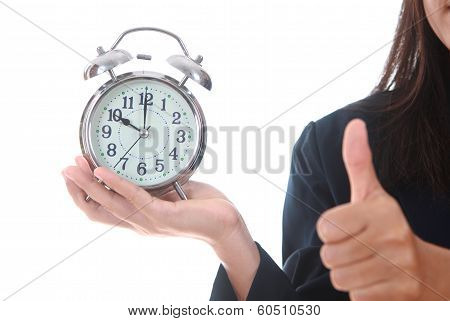 Copy Space An Alarm Clock With Woman Hand Showing Succes Sign