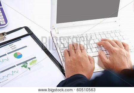 Close-up Shot A Hand Typing On Laptop Keyboard