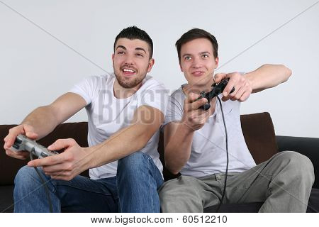 Young People Having Fun While Playing Video Games