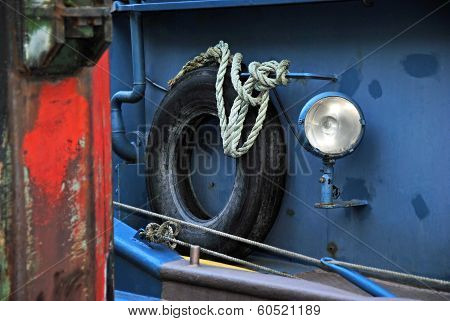 Detail of an old Boat with Lifebelt, Rope and Lamp