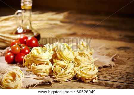 Raw pasta,vegetables ,olive oil and spices