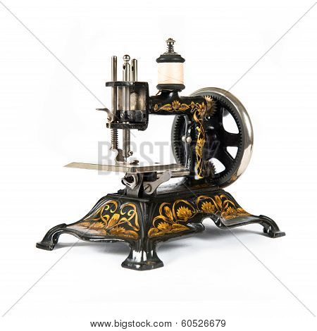 Retro Sewing Machine Over Isolated White Background