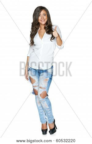 Happy young woman showing thumb up