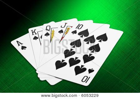 Playing cards. Casino games. Vegas casino table. Cards isolated over green.