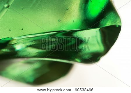 Waterdrops on a green bottle