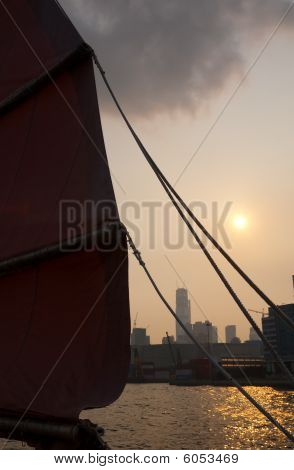 Scene At Sunset In Hong Kong On A Junk Boat