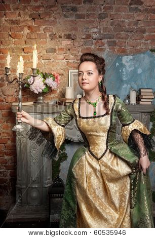 Beautiful Woman In Medieval Dress With Burning Candles
