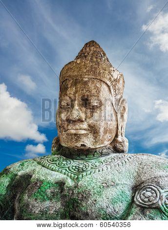 Asura statue on blue sky background, Siem Reap, Cambodia