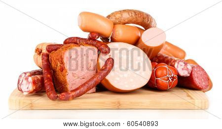 Lot of different sausages on wooden board isolated on white