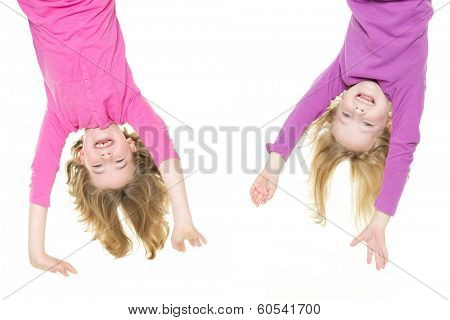 Smiling young girls hanging in front of white background