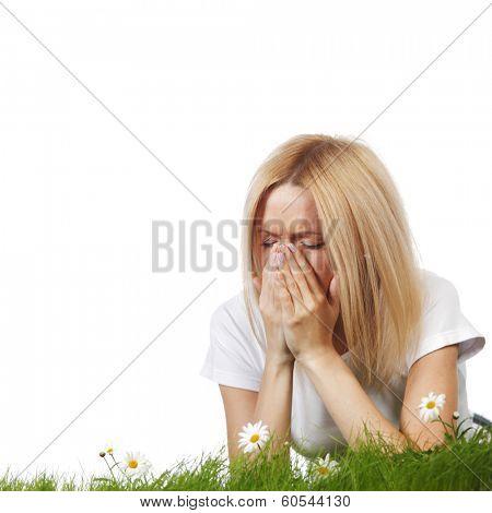 Pollen allergy, woman sneezing in a field of flowers