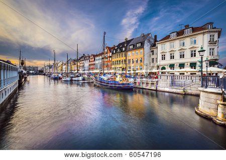 Copenhagen, Denmark at Nyhavn canal at dusk.