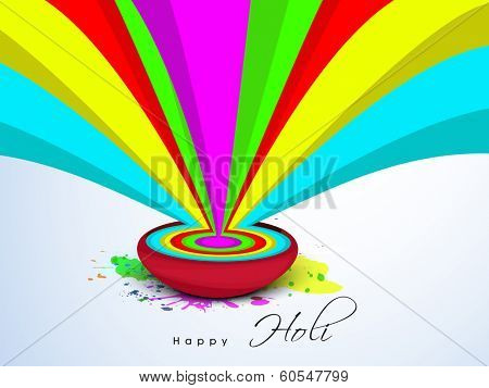 Indian colour festival Happy Holi celebrations concept with beautiful colours splash on blue background.