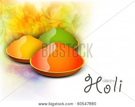 Indian festival Happy Holi celebrations concept with shiny colour splash on grey background.
