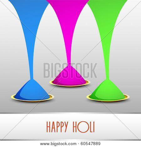 Indian festival Happy Holi celebrations concept with beautiful colours on grey background.
