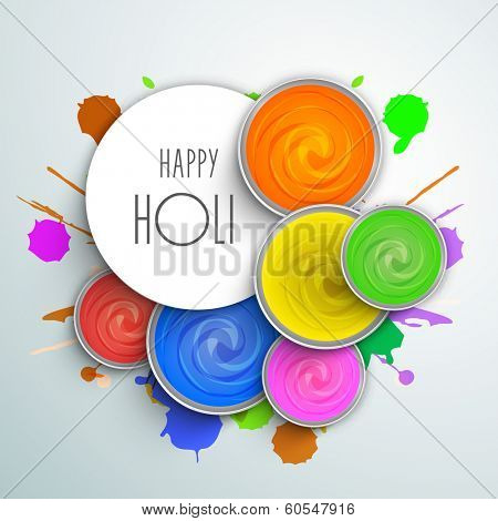 Indian festival Happy Holi celebrations concept with stylish text and water colours on blue background.