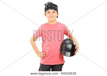 Young boy with headscarf holding a bikers helmet isolated on white background
