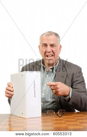 Baby-boomer businessman with annual report isolated on white