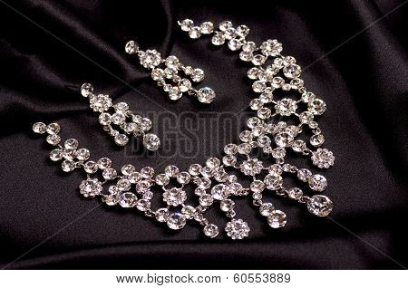 A collection of beautiful jewelry on a dark background