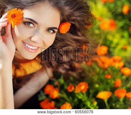 Enjoyment. Free Happy Woman Enjoying Nature. Beauty Girl Over Marigold Flowers Field. Outdoor Portra