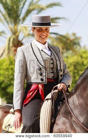 Female Rider Smilng