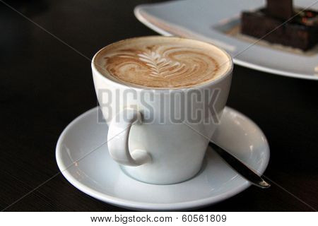 Cappuccino Cup With Drawing On Scum