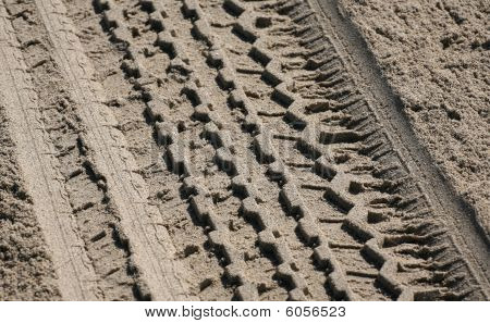 Tire Track In Beach Sand Background