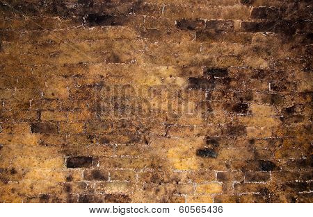 Brick wall inside of an old wine cellar as background