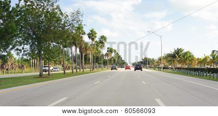 MIAMI, FLORIDA - DEC 24, 2009: Cars on road. Miami is a city located on the Atlantic coast in southeastern Florida and the county seat of Miami-Dade County
