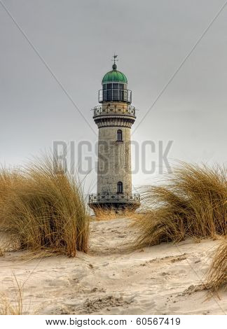 Lighthouse in sand dunes
