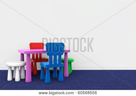 Kids Desk And Chairs Against A Wall