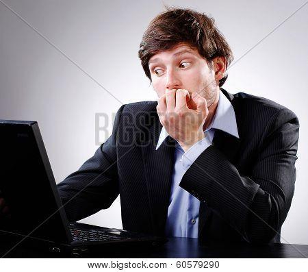 Man Shocked Looking At Computer