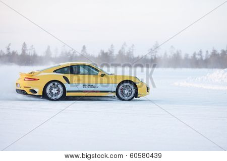LEVI, FINLAND - FEB 20: Unknown driver powerslides a PORSCHE 911 TURBO car during Porsche Driving Experience Snow & Ice Press Event on February 20, 2014 in LEVI, FINLAND