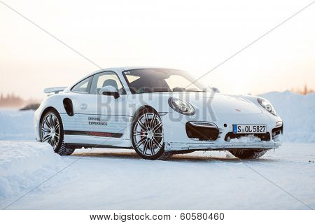 LEVI, FINLAND - FEB 20: Unknown driver drives a PORSCHE 911 TURBO car during Porsche Driving Experience Snow & Ice Press Event on February 20, 2014 in LEVI, FINLAND