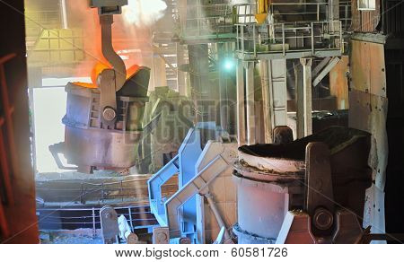 molten metal poured from ladle in factory